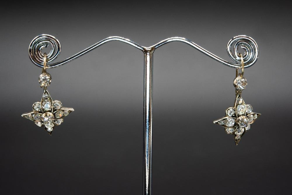 A PAIR OF LATE 19TH CENTURY DIAMOND SET EARRINGS, the