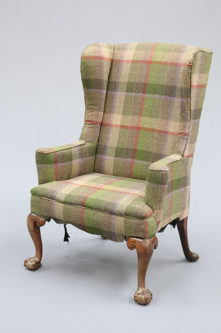 AN 18TH CENTURY WALNUT WING ARMCHAIR, upholstered with