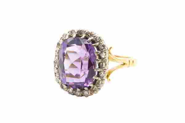 AN AMETHYST AND DIAMOND CLUSTER RING The cushion-cut