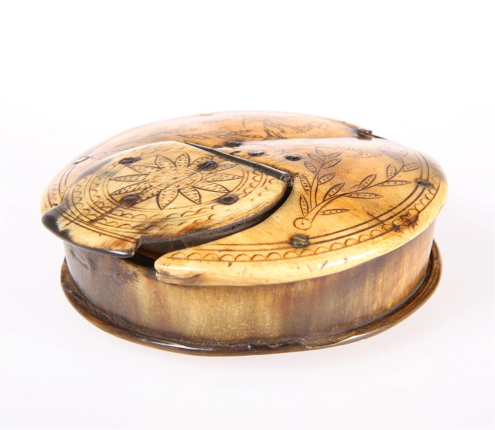 AN EARLY 19TH CENTURY HORN SNUFF BOX, circular,