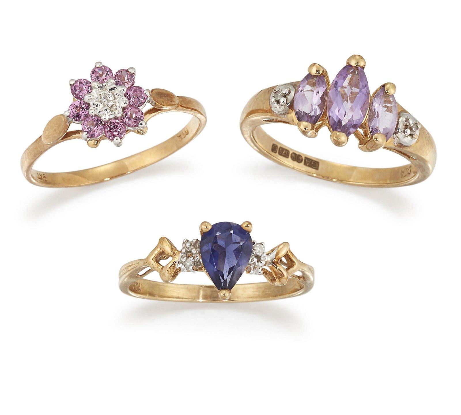 THREE 9CT DIAMOND AND GEMSET RINGS, a three stone
