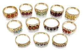 A QUANTITY OF 9 CARAT GOLD GEMSET RINGS to include