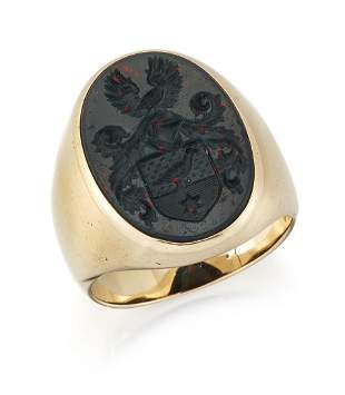 A BLOODSTONE INTAGLIO SIGNET RING, the oval bloodstone