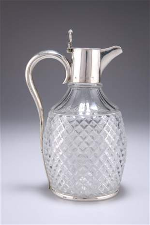 A VICTORIAN SILVER-MOUNTED CUT-GLASS CLARET JUG,by