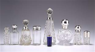 A GROUP OF SIX SILVER-MOUNTED GLASS SCENT BOTTLES AND