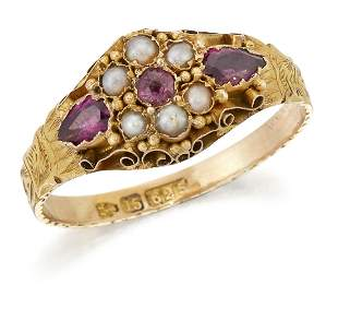 A VICTORIAN 15 CARAT GOLD GARNET AND SEED PEARL CLUSTER