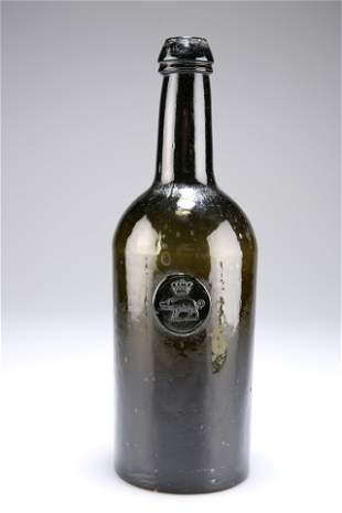 A GEORGIAN GREEN GLASS SEAL WINE BOTTLE, the seal with