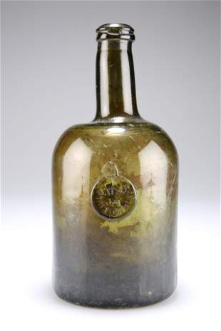 A GEORGIAN GREEN GLASS SEAL WINE BOTTLE, the seal