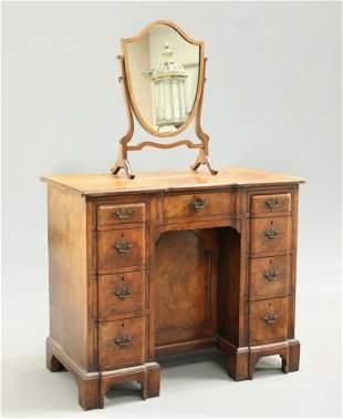 A GEORGIAN STYLE WALNUT KNEEHOLE DRESSING TABLE, the