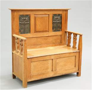 AN ARTS AND CRAFTS OAK SETTLE, the back with two