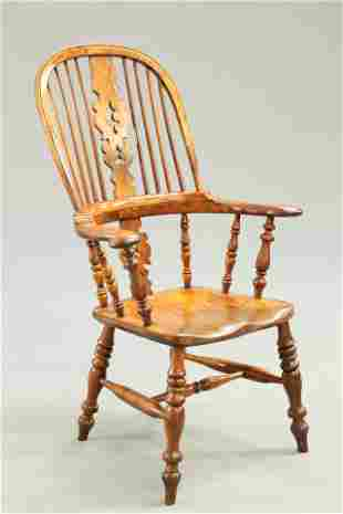 A 19TH CENTURY YEW WOOD BROAD-ARM WINDSOR CHAIR, SOUTH