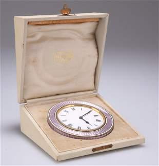 AN ENAMEL STRUT CLOCK, CIRCA 1920, the circular white