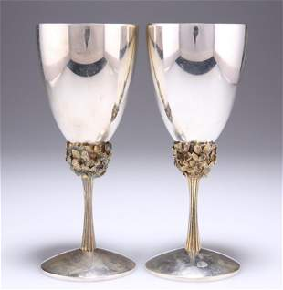 A PAIR OF ELIZABETH II PARCEL-GILT SILVER GOBLETS, by