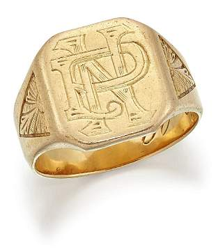 A SIGNET RING, the canted rectangular top engraved with