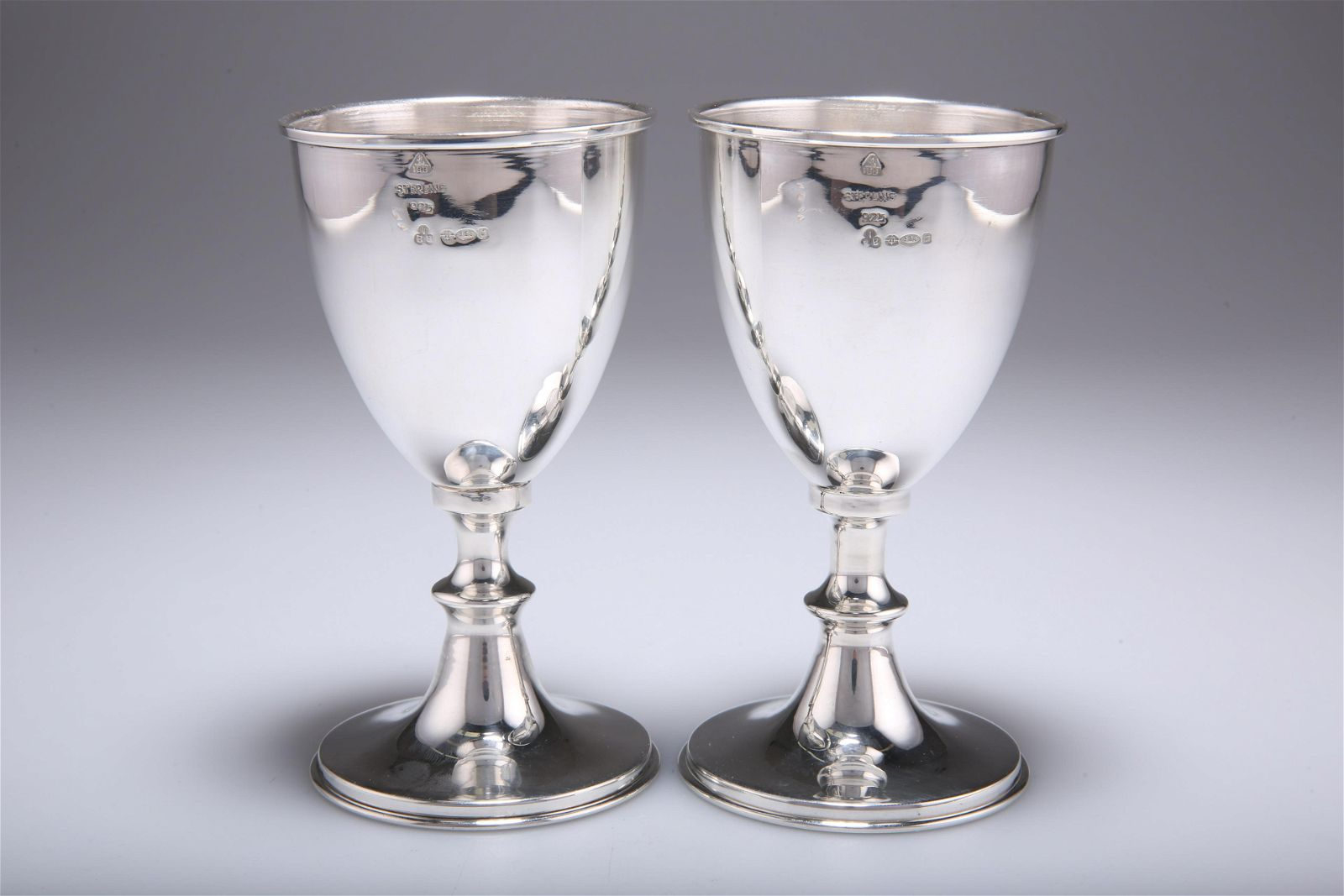 A PAIR OF ELIZABETH II SILVER IMPORT GOBLETS,