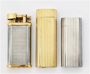 A GROUP OF THREE VINTAGE LIGHTERS, comprising two by