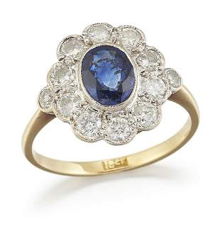 A SAPPHIRE AND DIAMOND CLUSTER RING, a oval-cut