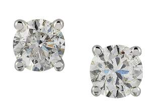 A PAIR OF SOLITAIRE DIAMOND EARRINGS, round