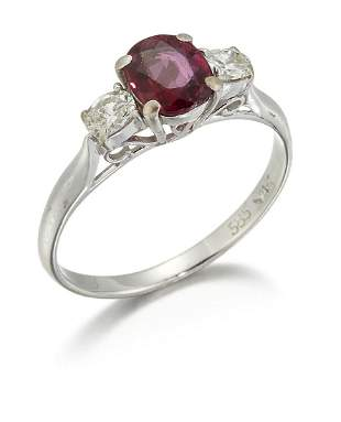 A RUBY AND DIAMOND THREE STONE RING, an oval-cut ruby