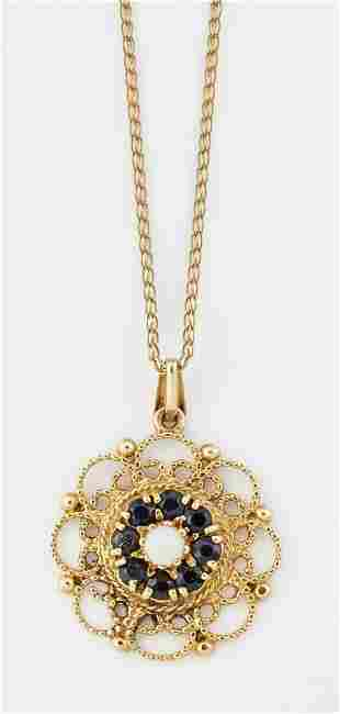 A 9CT GOLD OPAL AND SAPPHIRE PENDANT ON CHAIN, a round