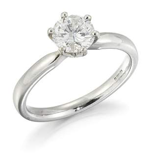 A PLATINUM SOLITAIRE DIAMOND RING, a round