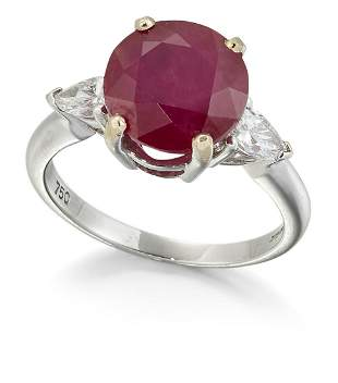 AN 18CT WHITE GOLD RUBY AND DIAMOND THREE STONE RING, a