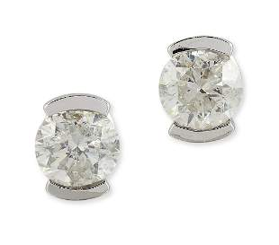 A PAIR OF 9CT WHITE GOLD SOLITAIRE DIAMOND EARRINGS,