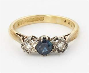AN 18CT GOLD SAPPHIRE AND DIAMOND THREE STONE RING, a
