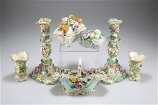 A GROUP OF FLORAL ENCRUSTED PORCELAIN, including a