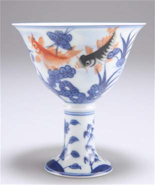 A CHINESE MING STYLE PORCELAIN STEM CUP, the bowl blue