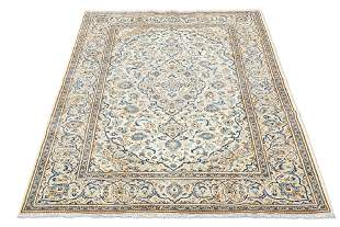 AN IRANIAN KASHAN CARPET, with cream ground. 290cm by