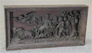 AN 18TH CENTURY CARVED OAK PANEL, carved in high relief