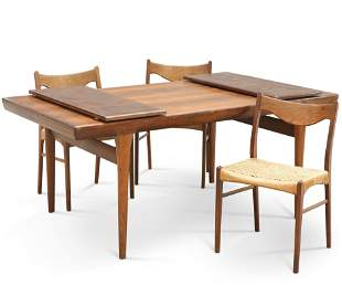 A DANISH ROSEWOOD EXTENDING DINING TABLE AND THREE