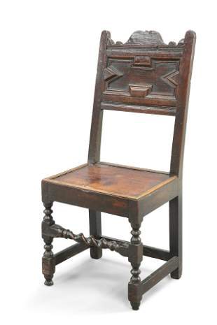 A 17TH CENTURY OAK PANEL-BACK CHAIR, with boarded seat