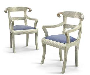 A PAIR OF SILVERED METAL ARMCHAIRS IN THE ANGLO-INDIAN