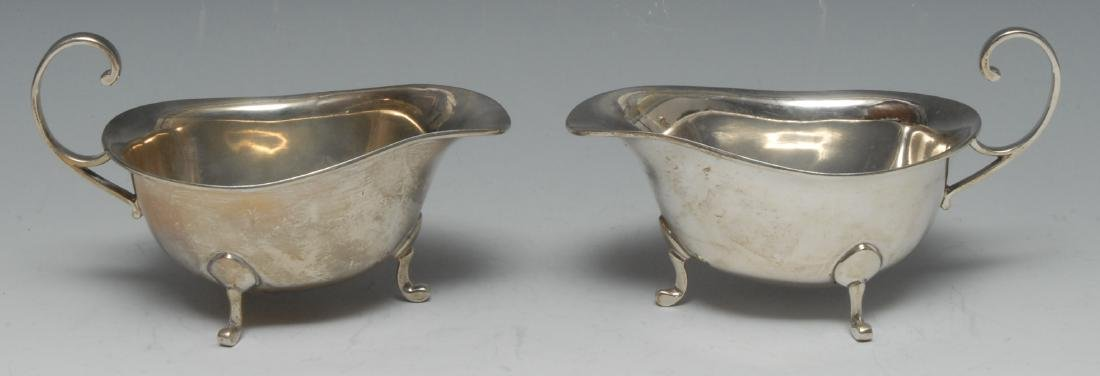 A pair of George V silver sauce boats, of George III