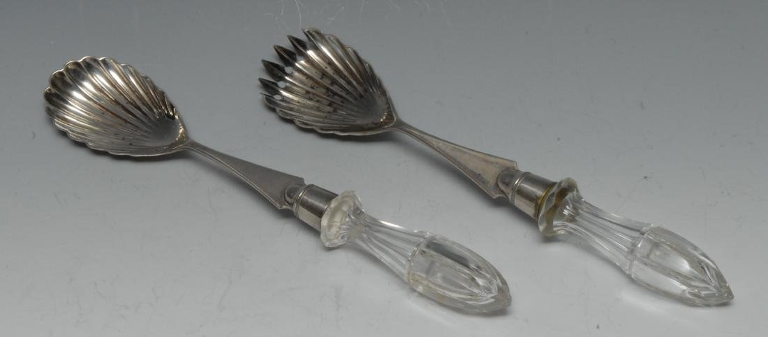 A pair of Victorian silver salad servers, shell bowls,