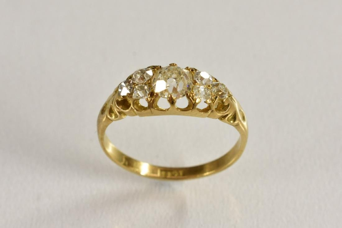A Victorian seven stone diamond ring, linear set with a
