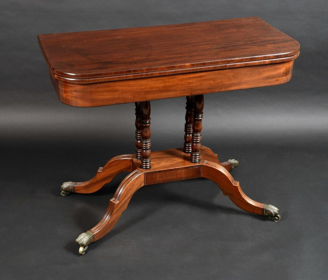 A Regency mahogany rounded rectangular card table,