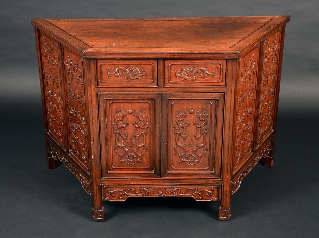 A Chinese padouk wood canted rectangular side cabinet,