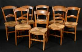 A harlequin set of eight 19th century French Provincial