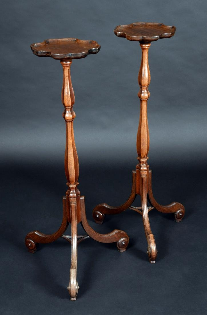 A pair of 19th century mahogany tripod candle stands,