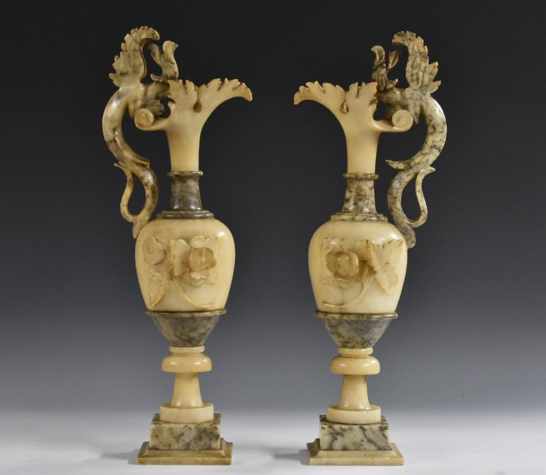 A pair of 19th century alabaster ewers, scrolling