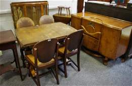 An oak drawer leaf table; four chairs; a Beautility