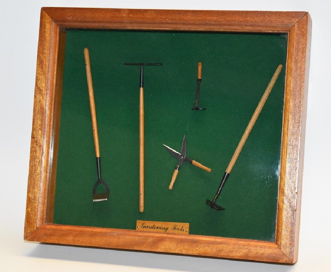An array of Dolls house gardening tools, in