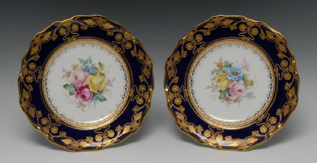 A fine pair of Royal Crown Derby shaped circular