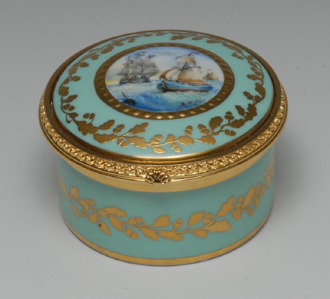 A Lynton porcelain circular table box, painted by