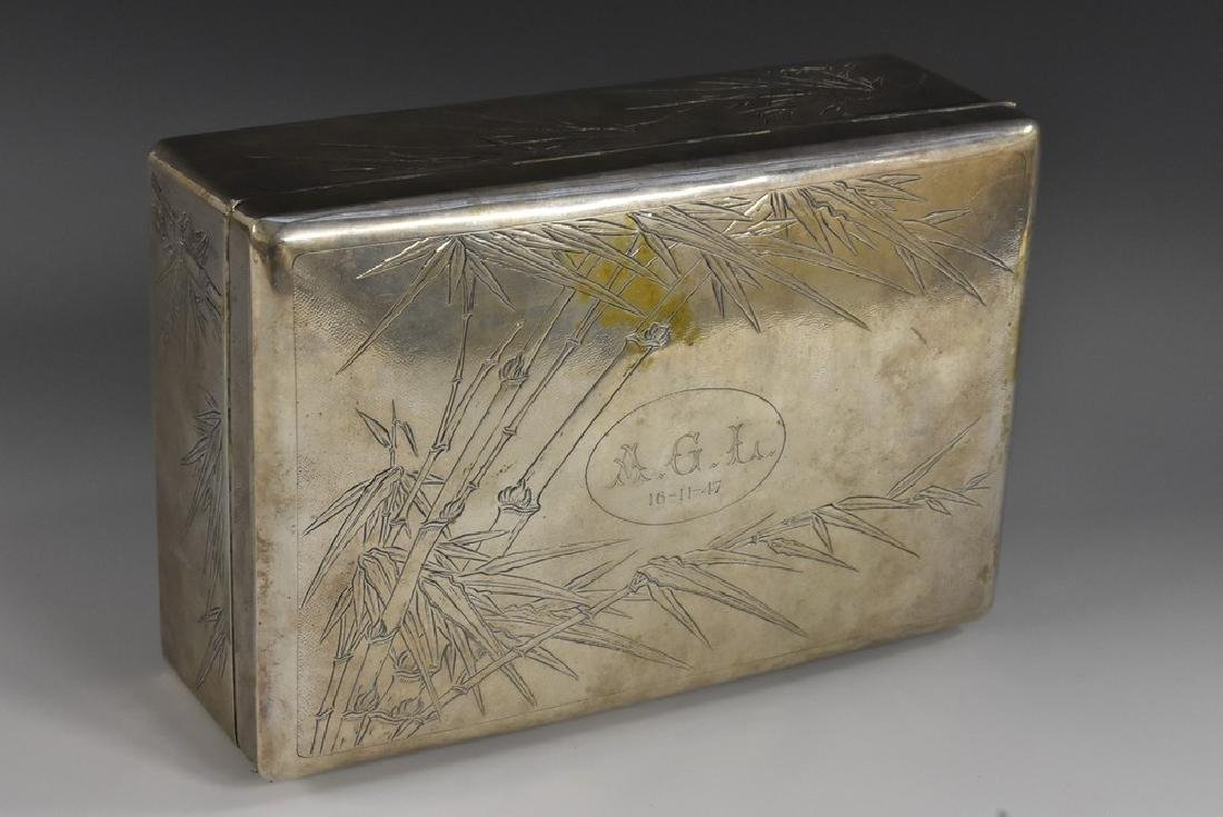 A large Chinese silver table cigar box, engraved with