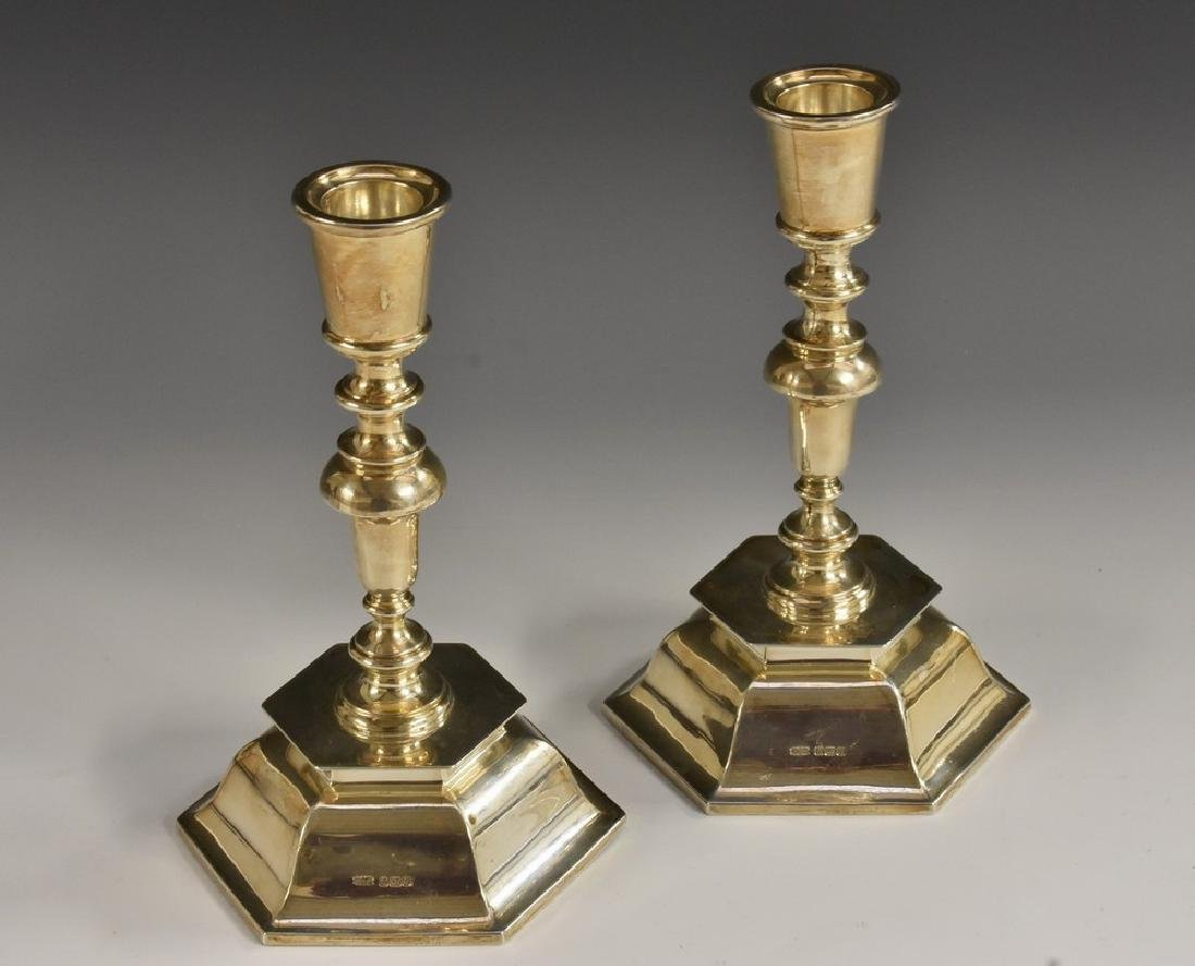 A pair of Edwardian silver candlesticks, of William &