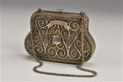 A Russian silver silver filigree bag shaped purse